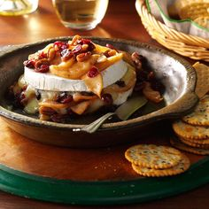 Apple-Pecan Baked Brie Recipe -As family arrives for a get-together, I make sure this fruity and savory Brie is in the oven so the aromas of cinnamon and apples fill the house. —Alicia Gower, Auburn, New York