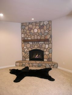 Corner fieldstone fireplace with insert