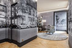 A cozy entrance way and reading area is dominated by an amazing mural called Saint Germain des Pres. The cityscape makes for a romantic addition to the interior and easy transition from outside to inside.