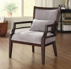 This lush oversized wood accent chair is a necessity to any home decor. The frame has a wood stained merlot finish, and the upholstery is in a gray luxurious polyester that feels like velvet. You will love sinking into this stylish and comfy chair.