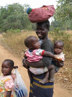 Woman carrying blanket and babies . by VBedard, via Flickr