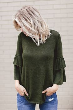 This olive green ruffle sleeve sweater is everything! Pair it with your favorite denim for a cute winter outfit! #fashion #style #outfits