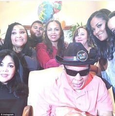 Family time: Ali poses with some of his seven daughters and two sons (above) at his most recent birthday party in January of this year