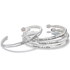 Silvertone open cuff bracelet that has a cap at one end that has clear and colored rhinestones. There is an inspirational message imprinted in black on the outside of the bracelet. Regularly $14.99, shop Avon Jewelry online at http://eseagren.avonrepresentative.com