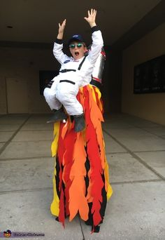 Renee: My son walks stilts (this is important) You might be able to make this same idea with your kid on the ground. I used a store bought costume and cut...