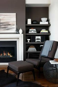 Wood Floor Dark Grey Chair  BlackGrey Wall Cool art above fireplace  white trim