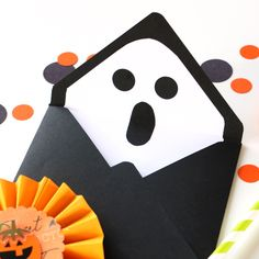 This Halloween send a card with a spooky surprise inside! Learn how to make cute ghost & pumpkin envelopes with the We R Memory Keepers envelope punch board.