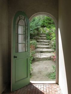 love this arched doorway leading to that beautiful garden