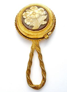 "Lady's Vanity - This is a vintage Revlon hand mirror compact with a celluoid floral design. It measures 4.5"" by 2.1"", has mirror on the outside and inside, both mirrors are excellent, very clean, has"