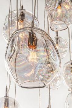 "John Pomp hand blown glass Infinity pendant. 11""w x 10""H."