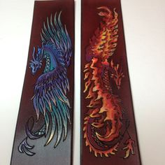 Commissioned cuffs- Air Dragon on the left and Fire Dragon on the right.  Pyrography, Hand Dyed Leather and Hand Painted.