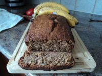 Good Recipe for a fairly moist and extremely flavorful Whole Wheat Banana Bread.  I soak my bananas in bourbon (slice, place in jar, pour bourbon over top, seal with clarified [melted] butter and place in the fridge until you're ready to make bread) to preserve them and add a little bit of extra malty sweetness.