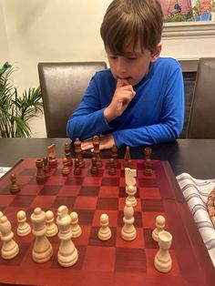 I love playing chess. And I love the fact that my two oldest kids love playing chess with me. This guy is shockingly good.... He hasn't beat me yet, but he's going to do it much earlier than I was able to beat my own father (who taught me how to play).