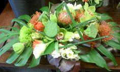 tropical Flower Arrangements Centerpieces | Large Tropical Centerpiece filled with Lotus Pods, Cymbidium Orchids ...