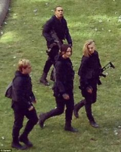 "Jennifer films ""Mockingjay"" in Paris alongside cast members Josh Hutchinson and Natalie Dormer."