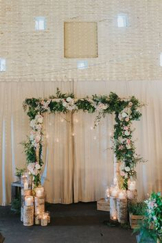 Wooden Arch with Floral Decor | Altar Decor | Pink & Gold Summer Wedding at East Riddlesden Hall Barn, Yorkshire | Laura Calderwoods Photography