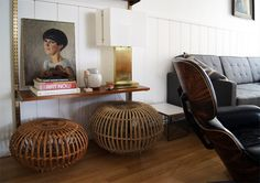Love the boho feel of Franco Albini ottomans mixed with mid-century pieces.