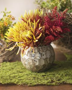 Our geometric mercury glass votive holder can serve double duty as a modern flower vase.