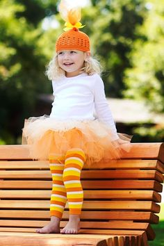 Candy corn costume. Love the tights!!  Oh how much I love to still be able to dress Little Miss B up in outfits that shell soon find really embarrasing! :)