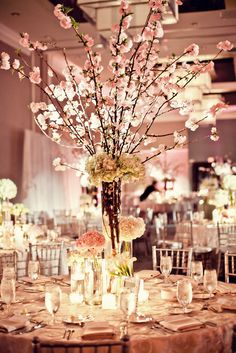 VESNA wedding & event weddings in Poland www.vesna.pl | cherry blossom centerpieces by Petal Productions