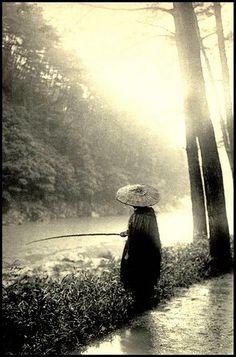 SUNLIGHT FALLING ON FISHERMAN AFTER A HEAVY RAIN -Japan 1920's