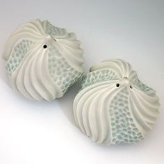White & blue porcelain urchin salt and pepper by robertapolfus..... you should see her work. STUNNING