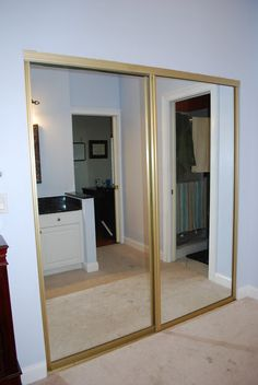 How to get rid of those gold mirrored closet doors!