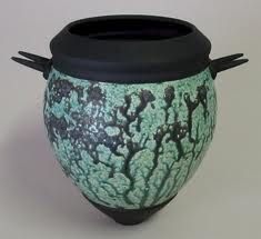 Rick Dela Cruz. You can find him at the San Diego Potters Guild. LOVE his work, I have been a fan for a very long time.