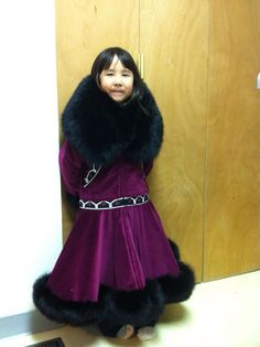 My daughter summer is wearing a velveteen parka trimmed with a black fox ruff and trim.