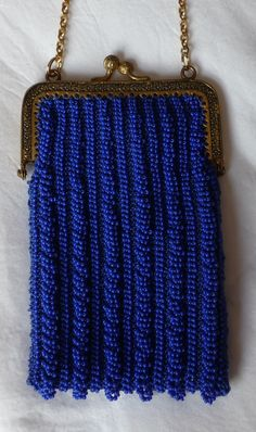 Beaded knitted purse on antique purse frame.