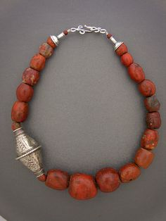 fabulous incredibly old jasper, possibly ancient, from West Africa. Combined with a very large and beautiful antique Baluch bead from the inhabitants of Baluchistan,. Coral Jewelry, Tribal Jewelry, Boho Jewelry, Jewelry Art, Gemstone Jewelry, Beaded Jewelry, Jewelery, Silver Jewelry, Jewelry Necklaces