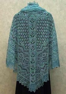 Create a figurative garden as you knit this shawl. Stroll with your needles down the flower-strewn paths that frame drifts of leaves, ferns and flowery borders. Based on Shetland lace patterns, this shawl is knit from the centre outwards and then the lacy leaf edging is added. Recommended for Experienced knitters.