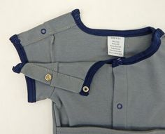 The CHARLIE is Kozie's little BOY STEEL GREY & NAVY Bodysuit. It is carefully designed for baby, toddler and the small child receiving G tube feeding/abdominal feeding, Monitors, Leads, Ports, I-Vs, Trachea, etc. This bodysuit easily gives the option for the baby/child to be dressed while laying on their back. This adorable sensory soft Kozie Bodysuit offers all front snap closure and snap closure at both shoulders and crotch for quick accessibility to G- Tube, Ports, cleaning around…