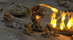 Possibly the most amazing Warhammer Fantasy Army you will ever see  A Daemons of Chaos army for Fantasy Battle and a truly awe inspiring one ! (the Cult of Fire designed and painstakingly constructed by Jody Tucker)