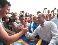"Russian Prime Minister Vladimir Putin (R) arm-wrestles during his visit to the summer camp of the pro-Kremlin youth group ""Nashi"" at lake Seliger, 400km north of Moscow, August 1, 2011."