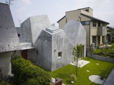 Concrete facade by Torafu Architects | Read more: http://torafu.com/works/koh#