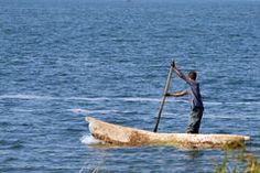Man in fisher boat Stock Photos
