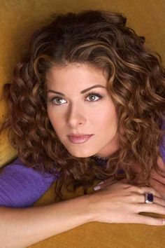 Debra Messing -beautiful curly hair http://tomybsalon.com/curly-hair-girls-rejoice-5-simple-tips-rocking-curly-hair/