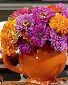 Zinnia Arrangement  Teeming with an assortment of brightly hued blooms, this lush and festive arrangement makes an ideal centerpiece for a Mexican-style fiesta for Cinco de Mayo. These dramatic, almost explosive colors are sure to make your guests feel as if they're dining on the beaches of Cancun or at the Mazatlan carnival.