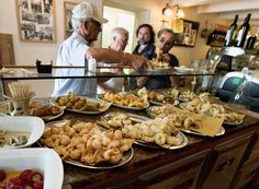 Customers order their cicchetti and wine at 'Ai Osti' bocaro on June 17, 2011 in Venice, Italy. The bacari, open just for lunch and dinner, ...
