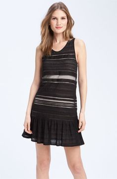 Theory 'Frenchela - Rhapsody' Sheer Stripe Drop Waist Dress      Streaky sheer stripes layer a solid lining creating chic, shades of contrast shaped into a sweet drop-waist dress with a ruffled hem.  •Lined.  •Cotton; dry clean.  •By Theory; imported.  •Individualist.  CAD 277.75