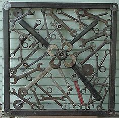 Decorative iron panel, tools, wrenches, sockets.. $450.00, via Etsy. (I really have to learn to weld!)