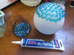 garden globes, crafts, mason jars, I started applying glass flat sided marbles Dollar Tree with this adhesive but they started sliding and I got impatient so I went to hot glue Worked great and no slipping