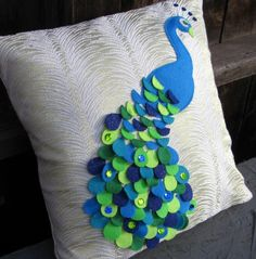 Recycled Felt Applique Peacock Pillow With Sequins. Could be easy enough to make.