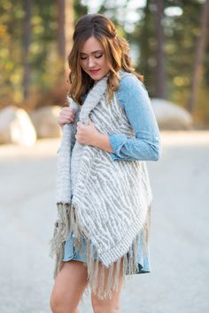 Too Soft To Touch Printed Fringe Vest Who can't resist this super soft printed fringe vest?! I know I can't! This fur vest is one of kind, it has a Taupe accent print that looks striped. #stripes #vest #sweater #fashion2015 #taupe #bohofashion