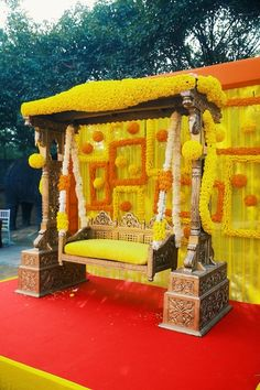 floral swing,floral decor,floral seating for bride,floral swing for mehendi,mehendi decor,floral decor for mehendi