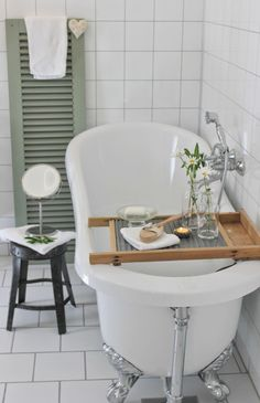 Love the shutter as a towel rail and washboard over the bath