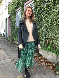 Green skirt and leather jacket