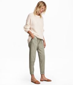 Light khaki green. Pull-on pants in woven Tencel® lyocell-blend fabric. Elasticized drawstring waistband, side pockets, and back pockets. Tapered legs with