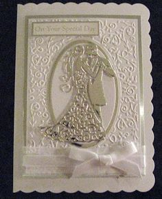 My Cherished Cards: Tattered lace couple - I used an embossing folder for the frame and think it was a Docrafts folder. This folder has an oval in the centre but I added extra die cut ovals in silver and white to add dimension.
